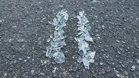 fragments: broken glass fragments on the cement texture