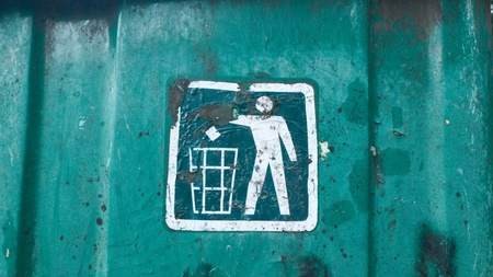 old sign: recycling bin sign. old metal dirty rusty