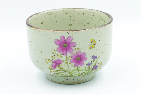 Traditional japonese tea cup with three pink flowers