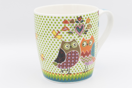 Coffee mug with tow owls on the side Stock Photo