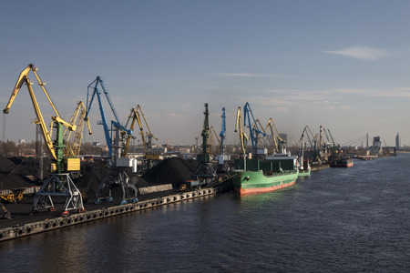 mining ship: Coal charging harbor in port of Riga city. Editorial