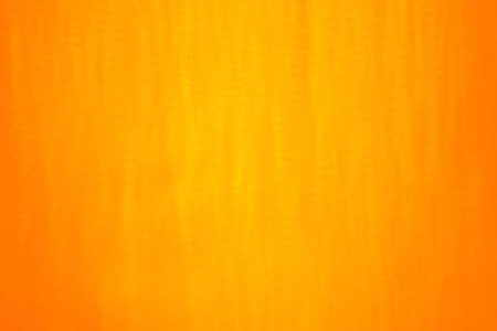 orange texture: Orange - yellow - red - gold background. It is slow shutter speed photo of snow fall in night in lantern light. This close up shot of blurred snowing in warm lights can be a Christmas or winter texture. Stock Photo