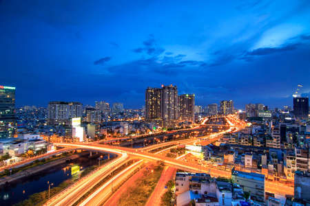 This is a landscape art picture. The author took the picture when the night came in Ho Chi Minh City, Vietnam. There are skyscrapers here, with lots of shimmering lights. There are buildings quietly l