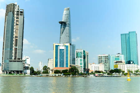 The author takes pictures at the river bank of district two (Ho Chi Minh City). The author takes a photo shoot on the evening 18/3/2021. The content shows the buildings that reflect the Saigon River.