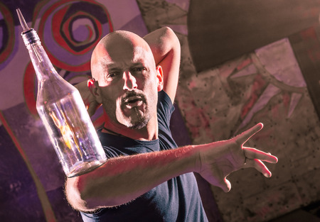 flair: Acrobatic Barman in Action - Freestyle american Bartender Stock Photo