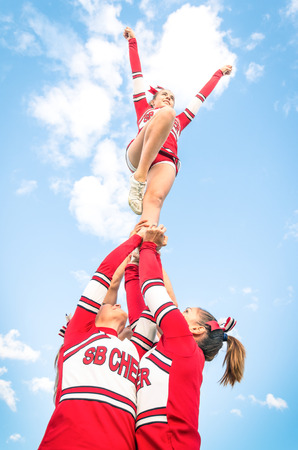 equipoise: Cheerleaders team during Competition outdoors Stock Photo