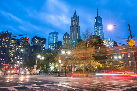New York City traffic - Blurred lights at blue hour with Manhattan skyline in the background