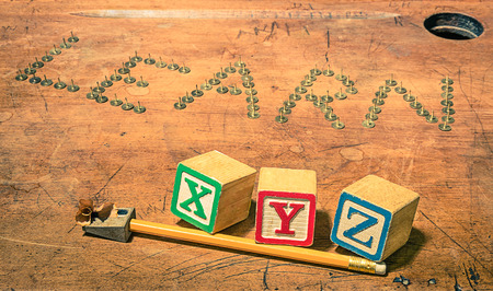 xyz: Vintage school desk with composition of pencil penknife and baby cubes letters - Concept of studying and learning