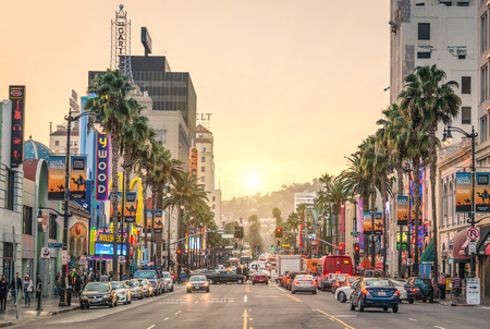 the entertainment industry: LOS ANGELES - DECEMBER 18, 2013  View of Hollywood Boulevard at sunset  In 1958, the Hollywood Walk of Fame was created on this street as a tribute to artists working in the entertainment industry  Editorial