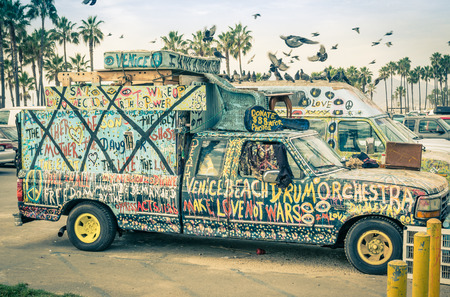 VENICE, UNITED STATES - DECEMBER 18, 2013  hippie artistic minivan on the Ocean Front Walk in Venice Beach  The image has been edited with a vintage retro nostalgic filtered look