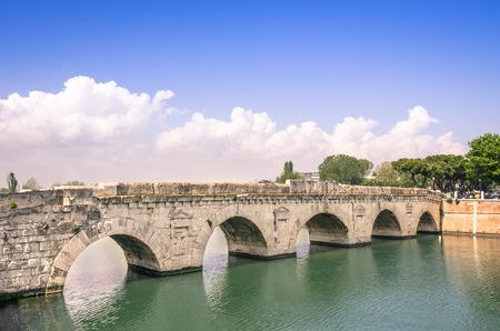 rimini: Roman Tiberius Bridge on Marecchia river in Rimini, Italy