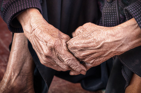 Dramatic hands of an old unidentified Person photo