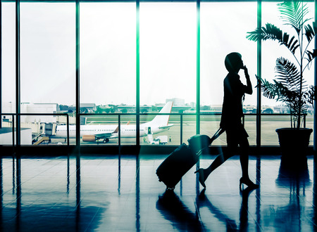 Business woman at Airport - Silhouette of a passenger photo