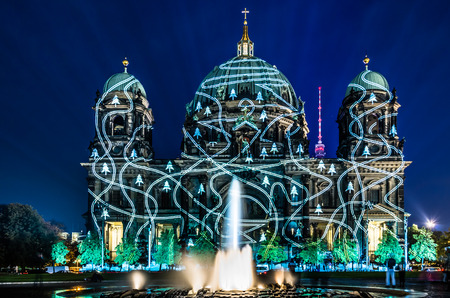 BERLIN, GERMANY - OCTOBER 16, 2012: Berliner Dome illuminated by colorful images during the world famous Festival of Lights. The 2014 event will take place from 10th to 19th october.