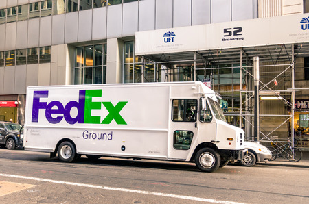 NEW YORK CITY - NOVEMBER 21, 2013: FedEx van delivering in downtown Manhattan. The name FedEx is the short version of the company original air division, Federal Express, which was used until 2000.