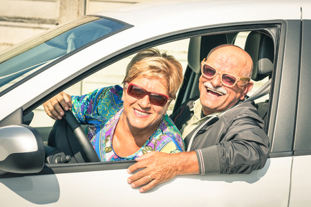 senior adult: Happy senior couple ready for driving a car on a journey trip - Concept of joyful active elderly lifestyle with man and woman enjoying their best years