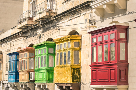 colorfull: Vintage view of typical buildings balconies in La Valletta  - Colorful travel in Malta on the road - Popped up filtered version