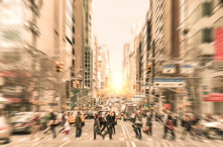 People on the street on Madison Avenue in Manhattan downtown before sunset in New York city - Commuters walking on zebra crossing during rush hour in american business district 版權商用圖片 - 32845247
