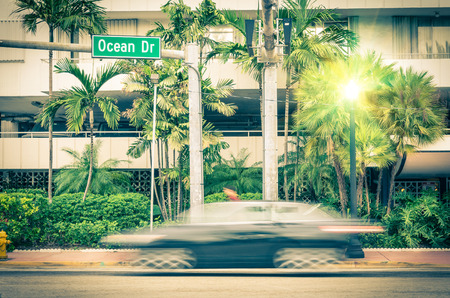 Modern car speeding along Ocean Drive in Miami South Beach before Sunset