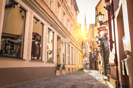 small country town: Vintage retro travel image of a narrow medieval street in old town Riga at sunset