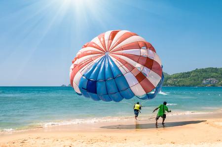 Parasailing at Patong Beach in Phuket - Thailand extreme Sports Stock Photo