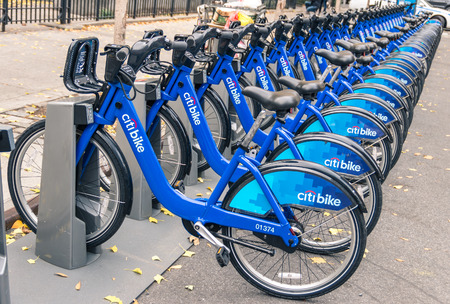 bycicle: NEW YORK CITY - NOVEMBER 21, 2013: New blue CitiBikes lined up at the exit of Grand Central Terminal in Manhattan downtown. Citi Bike is the largest bike sharing program in the United States. Editorial