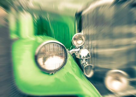 oldtimer: Close up of a vintage retro classic car - Vintage filtered look with popped up green color Editorial