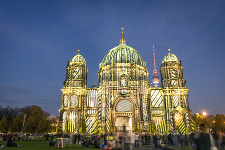 BERLIN, GERMANY - OCTOBER 19, 2014: Berliner Dome illuminated by colorful images during the world famous Festival of Lights. The 2014 event will took place from 10th to 19th october.