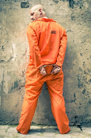 inmate: Dead Man Walking - Prisoner with Handcuffs standing proud Stock Photo