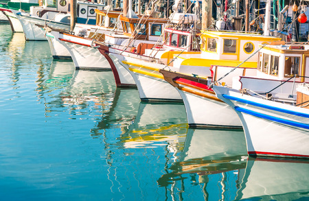 work boat: Colorful sailing boats at Fishermans Wharf of San Francisco Bay - California - United States