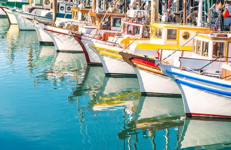 wharf: Colorful sailing boats at Fishermans Wharf of San Francisco Bay - California - United States