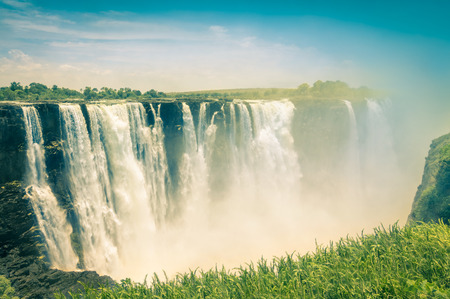 waterfall with sky: Vintage postcard of Victoria Waterfalls - Natural wonder of Zimbabwe - Continent of Africa