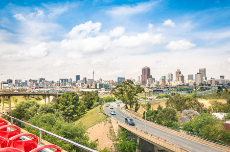 and south: Wide angle view of Johannesburg skyline from the highways during a sightseeing tour around the urban area - Metropolitan buildings of the business district in the capital of South Africa