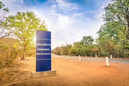 Welcome sign at Zimbabwe border with Zambia - Entrance to the village of Victoria Falls Stock Photo