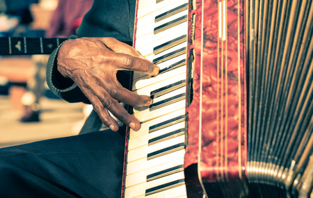 African musician hand playing fisarmonica - Street artist performing traditional songs with accordion Standard-Bild