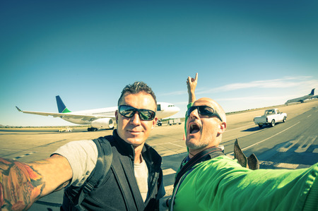 best friend: Modern hipster young friends taking a selfie at international airport - Adventure travel lifestyle enjoying moment and sharing happiness - Trip together around the world as alternative lifestyle