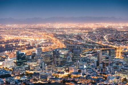 aerial view city: Aerial view of Cape Town from Signal Hill after sunset during the blue hour - South Africa modern city with spectacular nightscape panorama