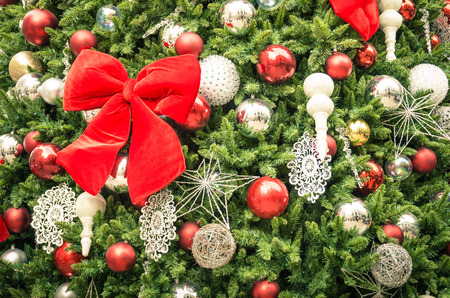 rule of thirds: Detail of Christmas tree decorations with red ribbon - Cropped composition for holidays background Stock Photo