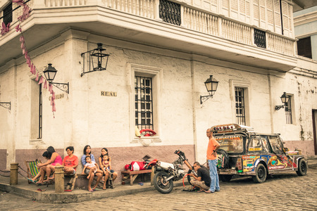 MANILA, PHILIPPINES - 29 JANUARY, 2014: everyday street life in the district of Intramuros, which was the seat of the government when the Philippines were a component of the Spanish Empire. Editorial