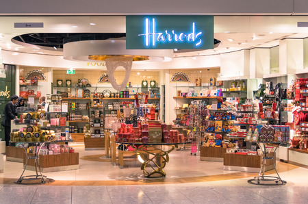 harrods: LONDON - NOVEMBER 5, 2014: Harrods store at London Heathrow International Airport. The Harrods motto is Omnia Omnibus Ubique which means All Things for All People, Everywhere