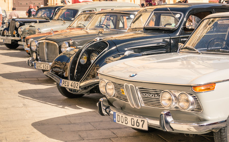 pawl: MDINA, MALTA - OCTOBER 10, 2014: vintage classic retro cars parked in San Pawl square. The ancient capital Mdina is a medieval walled town situated on a hill in the centre of the island