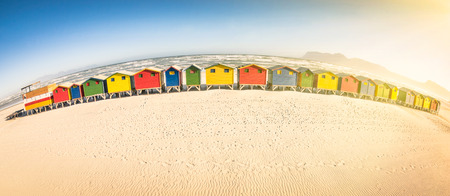 Multicolored beach huts at St James seaside near Simon Town - Atlantic pacific coast near Cape Town in South Africa photo