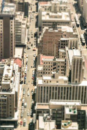 tilted view: Skyscrapers and everyday people life in the business district of Johannesburg - Aerial view of modern buildings of the skyline in South Africa biggest city - Tilted shift defocusing