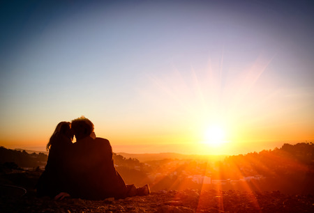 beach kiss: Couple in Love at Sunset - San Francisco Twin Peaks Stock Photo
