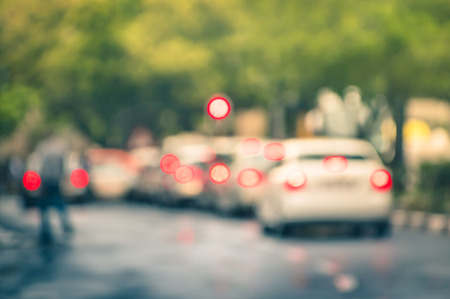 busy street: Defocused cars in city traffic jam in a rainy day - Johannesburg suburb streets with blurred bokeh Stock Photo