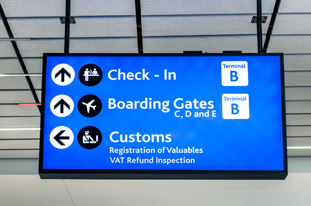 Info sign at international airport - Directions for check in and boarding gates - Registrations and custom at terminal connections Stock Photo