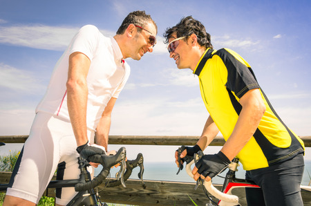 other world: Sport challengers ar bike race - Bicycle competition international world championship - Concept of challenge and loyalty together against doping issues - Two bikers facing each other Stock Photo