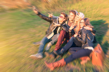 mauer: Group of young hipster best friends taking a selfie at Mauerpark in Berlin - Concept of friendship and fun with new trends and technology - Urban alternative everyday life in Berlin european capital Stock Photo
