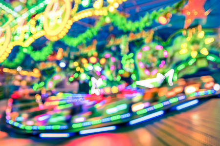festival moment: Blurred defocused lights at luna park carousel roundabout - German christmas market at Alexander Platz in Berlin - Fantasy imagery of childhood fun games and dreams