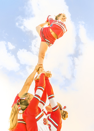 equipoise: Young cheerleader balancing toward the sky - Cheerleaders Team